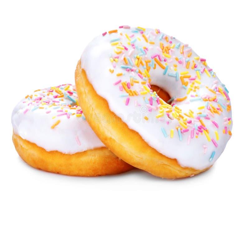 Donuts som isoleras på vitbakgrund arkivfoton
