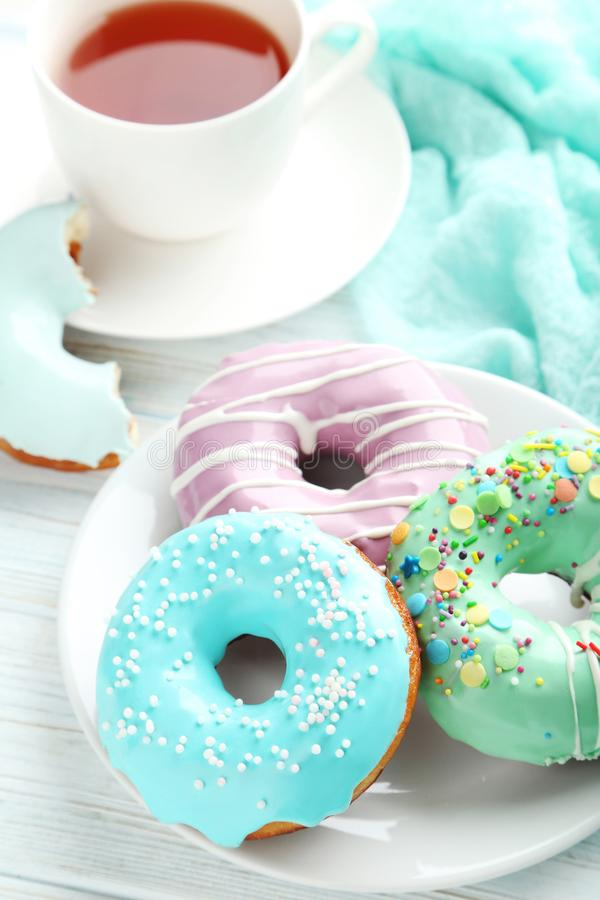 Donuts with sprinkles royalty free stock photos