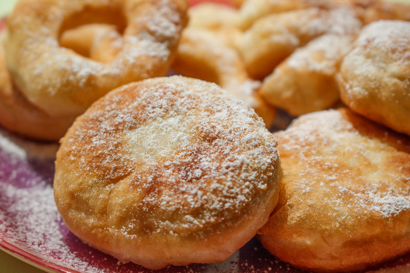 Donuts. Is a type of fried dough confectionery or dessert food. The doughnut is popular in many countries and prepared in various forms as a sweet snack that can stock images