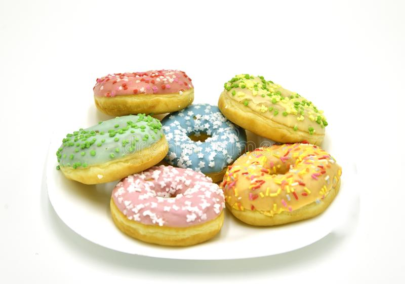 Donuts. Various donuts. Pile of assorted donuts isolated on white background stock photos