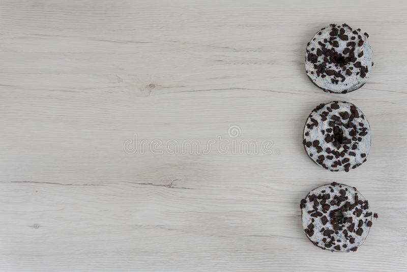 Donuts on a white wood background. Top view, copy space stock photo