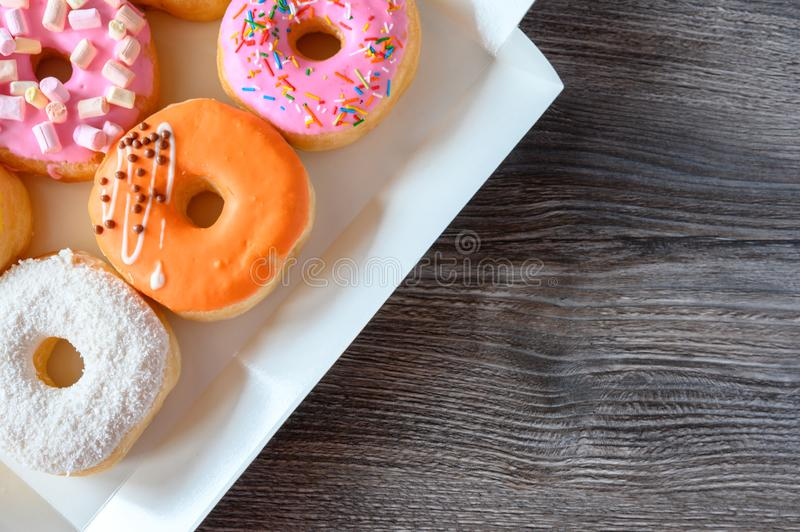 Donuts on a wooden table stock image