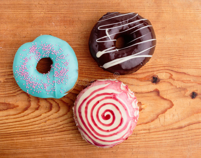 Donuts on wooden table stock photos