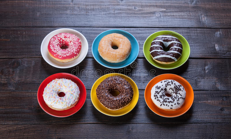 Donuts on wooden table. stock photography