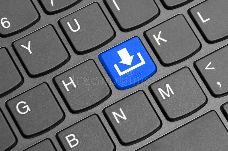 Donwload button on keyboard. Download icon button placed on laptop black keyboard background - studio image stock photo