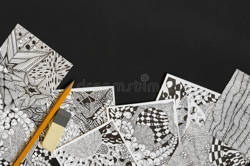 Doodle, zen tangle illustration. Zen art, doodle patterns for the beginners. Sketch illustrations, a pencil and eraser on the dark. Wooden table. Lesson for stock image