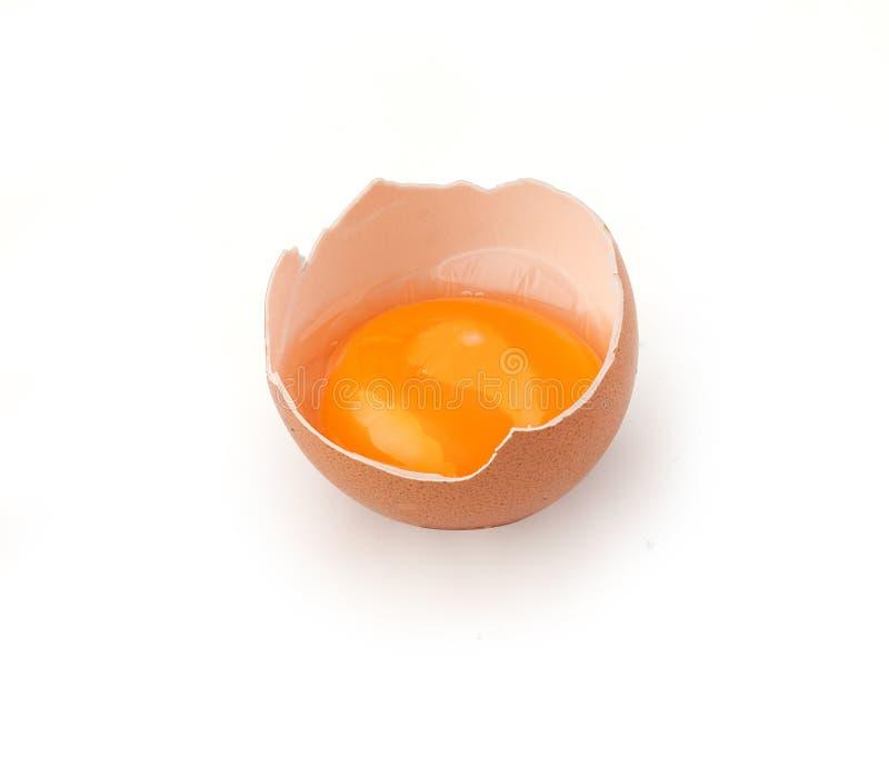 Dooier in de eierschaal stock foto's