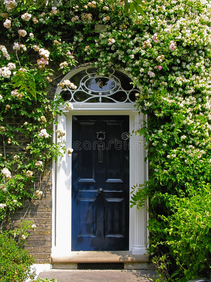 Door. Traditional English victorian front door. Surrounded by flowers