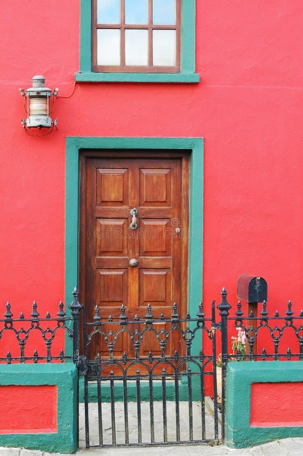 Door. Eight panel wood grain door with center knob stock photo