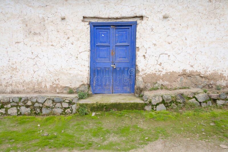 Wooden door in the Peruvian Andes stock photo