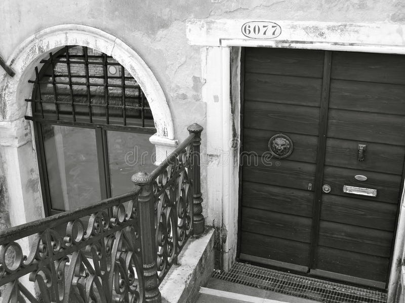 Door and arched window in Venice royalty free stock images