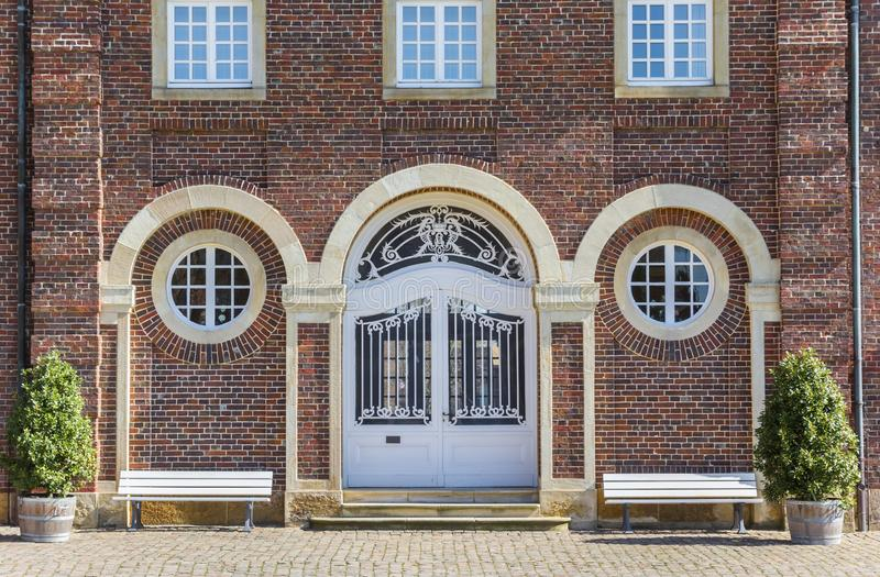 Door and benches of the castle of Nordkirchen royalty free stock photography