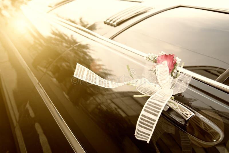 Door of black wedding car with flower stock images