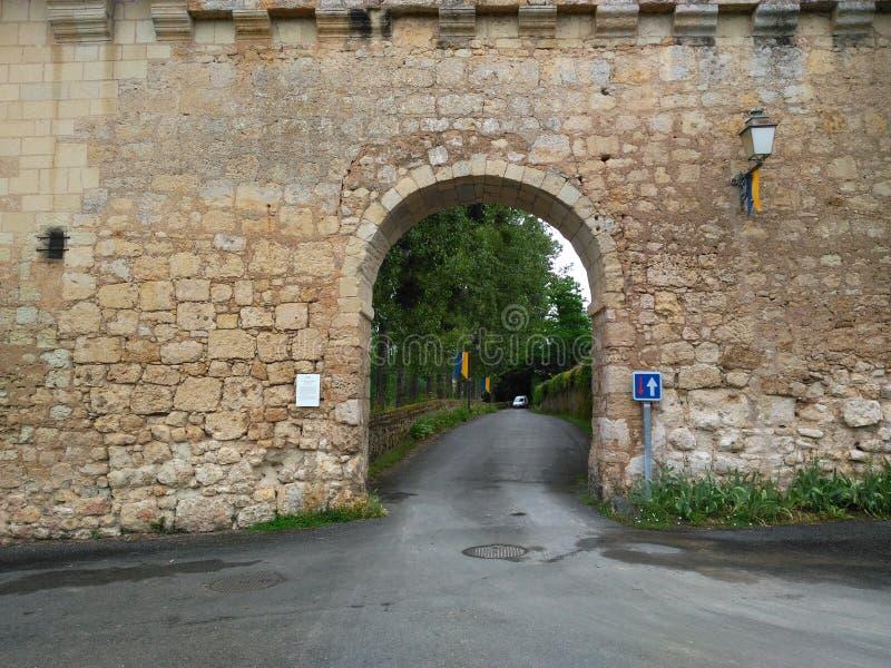 Wall XVI century. Door bridge lamp Road path Stone hole greenery green Window stock images