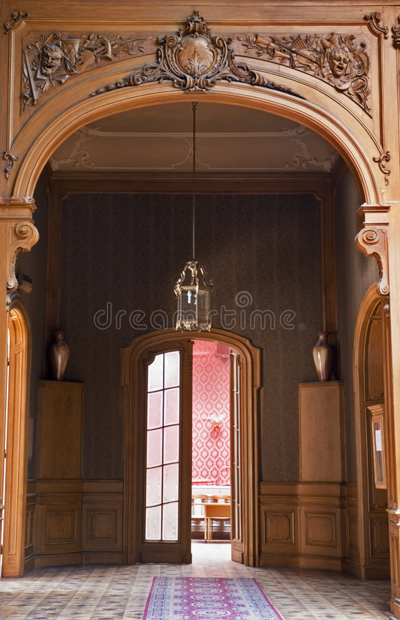 Door and chandelier royalty free stock image