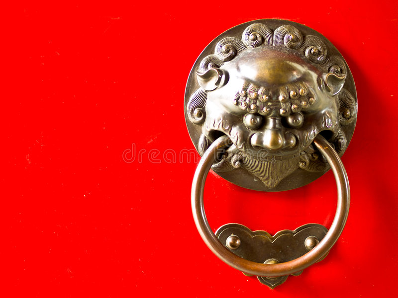 Brass ornamental knocker designed in the traditional Chinese manner namely as a demon dog with the face of a lion intending to ward of evil by being more ...  sc 1 st  Dreamstime.com & Door Demon stock photo. Image of luck ornamental traditional - 3181780
