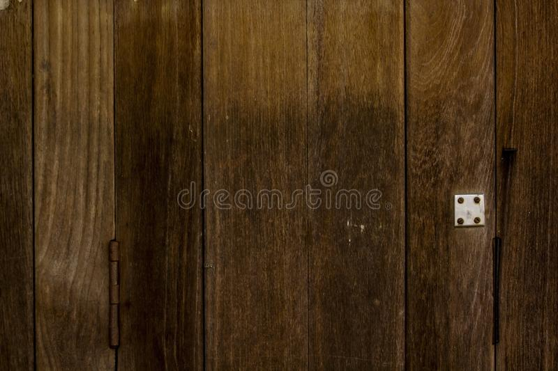 Door details made of lath. Old wooden door profile made of lath has brown color stock photos