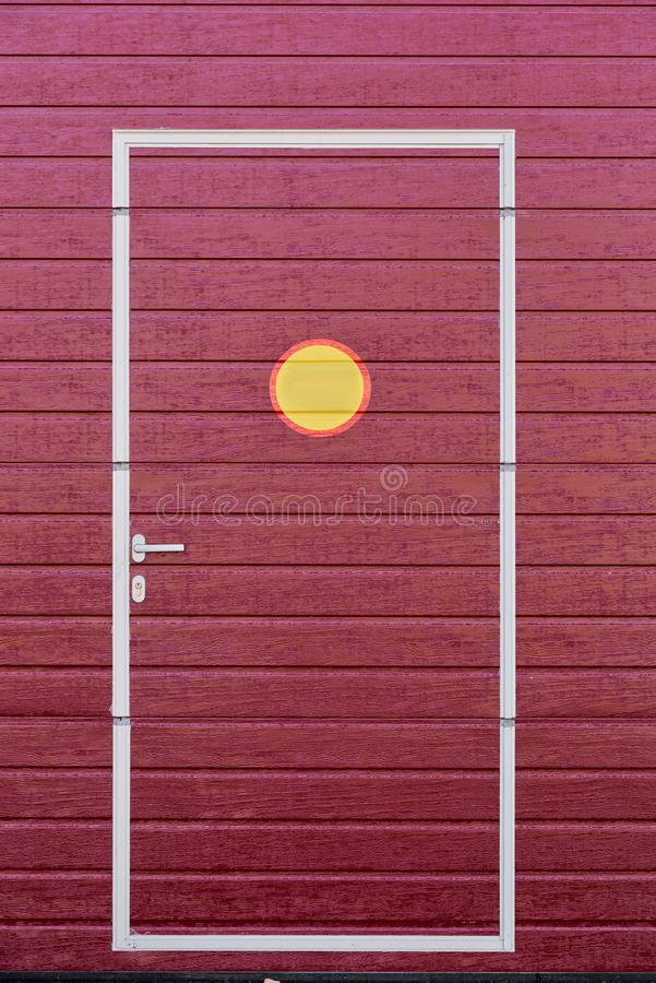 Door drawn on wall. Dark-red door drawn on bright painted wooden wall royalty free stock photos