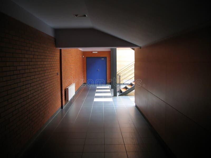 Door at the end of corridor stock photos