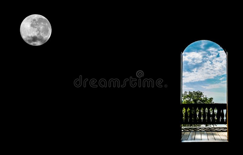The door in the form of an arch overlooking the summer landscape nature on a black background with a full moon.  royalty free stock photography