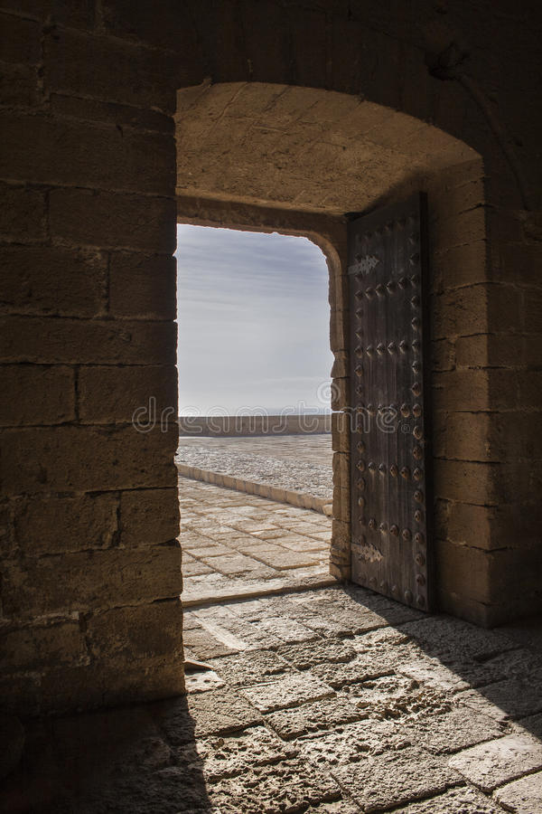 Door The fortress. The fortress (from the Arabic al- kasbah القصبة ' citadel ' ) is a fortified building or urban character whose function royalty free stock photography