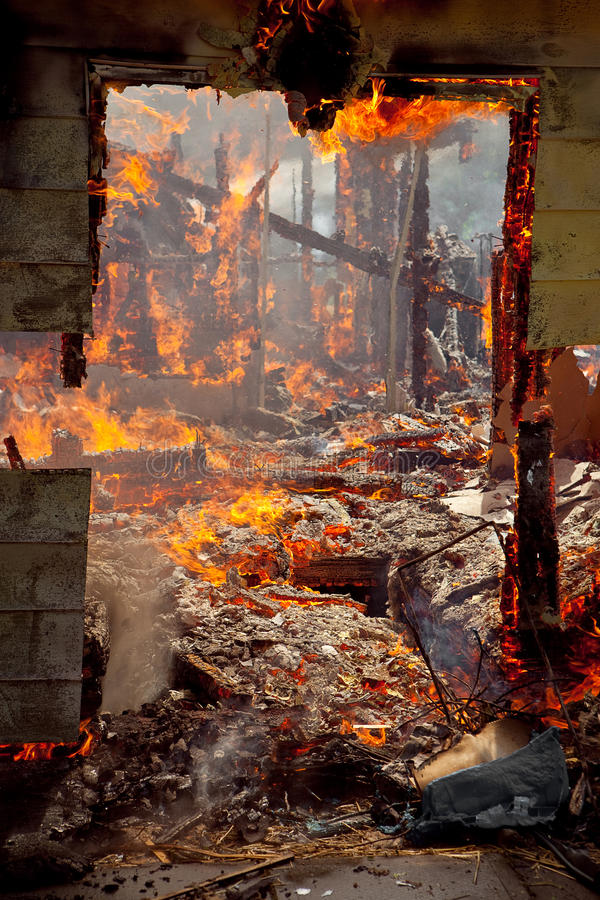 Door frame of a House on fire stock photography
