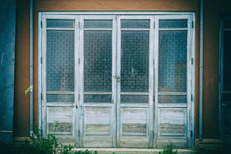 Door with glass. Locked glass door in old building stock photography