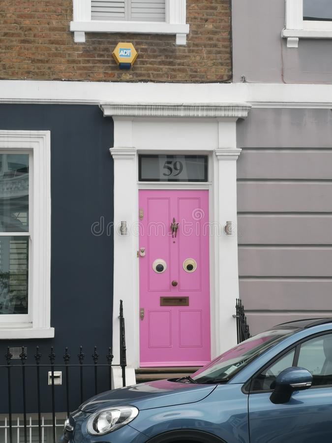 Door with googly eyes. Funny royalty free stock image