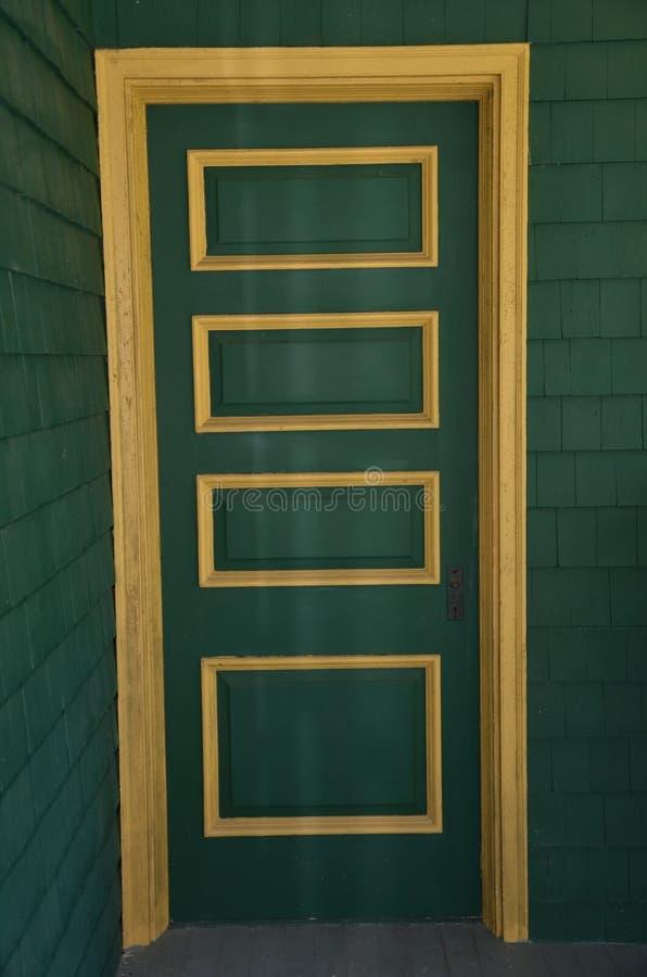Door. Grand green and gold entryway stock photos