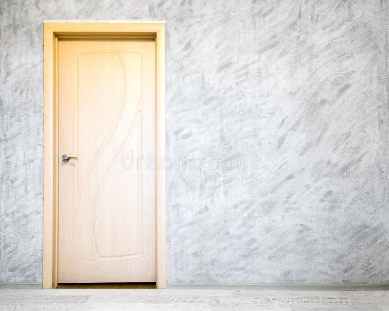 Door in grey room. New door to a beautiful interior with grey wall royalty free stock photos