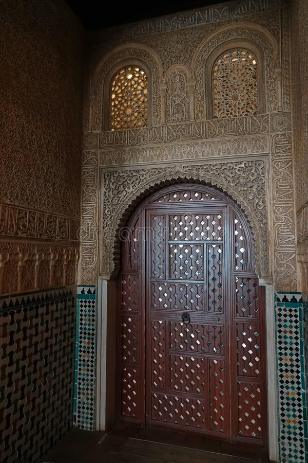 Door at the Hall of the Ambassadors at Nasrid palace of the Alhambra in Granada, Andalusia. Door decorations with arabesque ornaments at the Salon de Embajadores stock photos