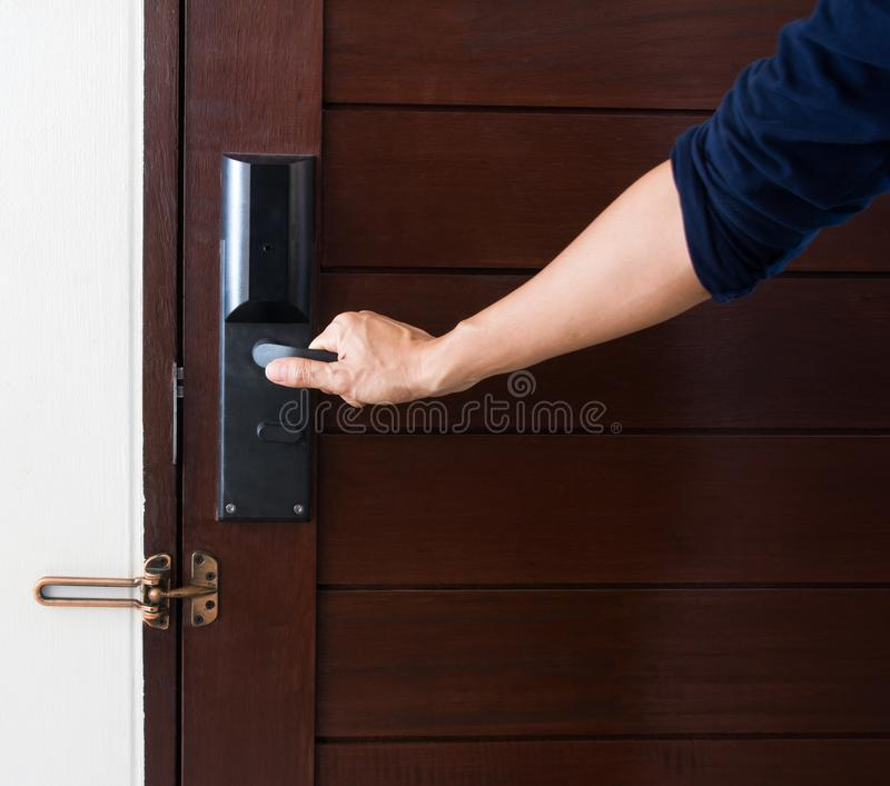 Door with a hand on handle stock photography