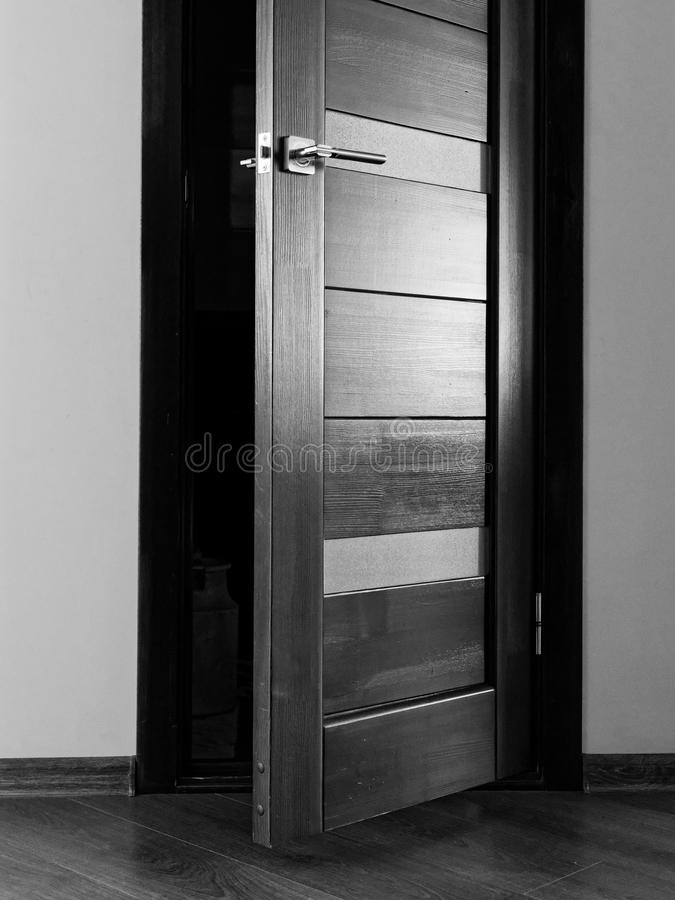 Interior wood doors with a metal handle royalty free stock images