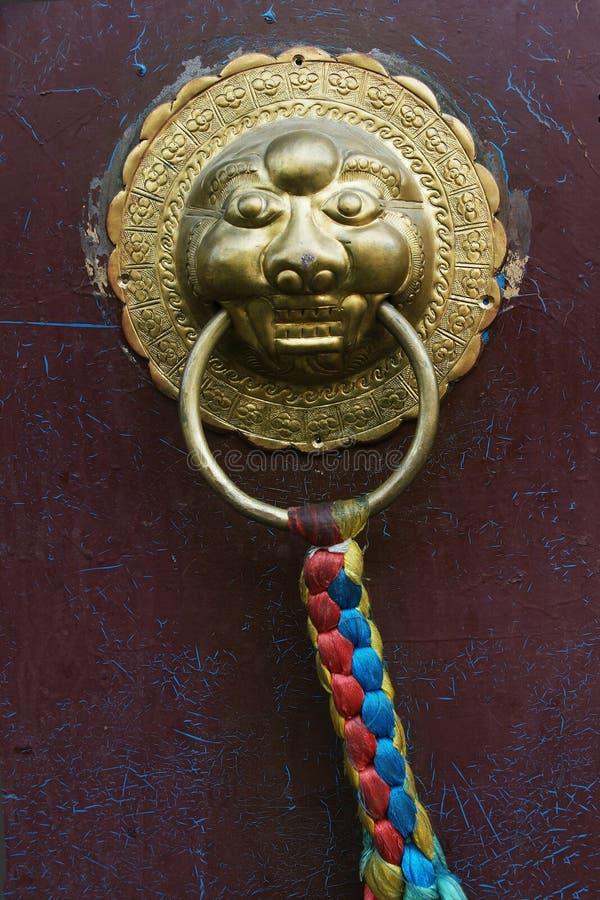 Door handle with lion design royalty free stock photo