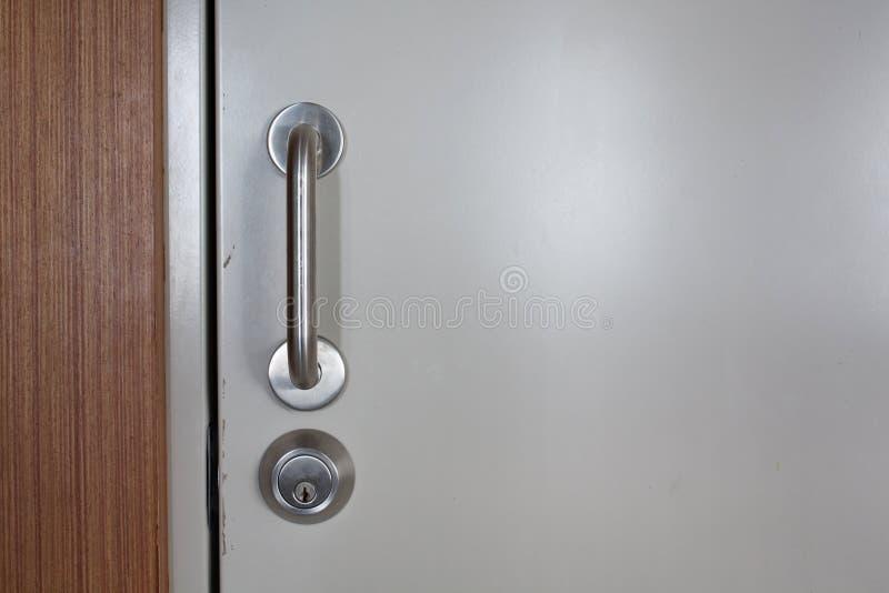 Door handle. On the door with lock stock photo