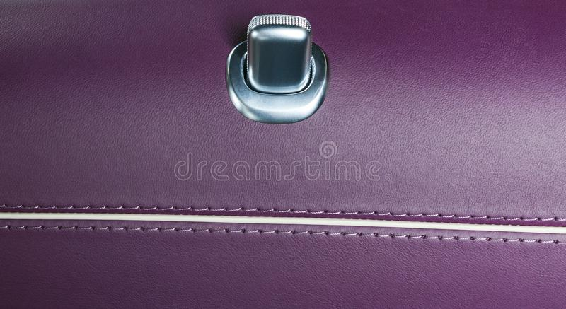 Door handle with lock control buttons of a luxury passenger car. Brown leather interior of the luxury modern car. Modern car inter. Ior details royalty free stock photos