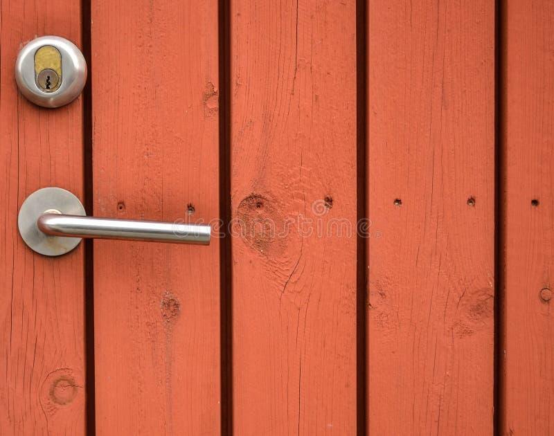 Door handle on old wooden door stock photography