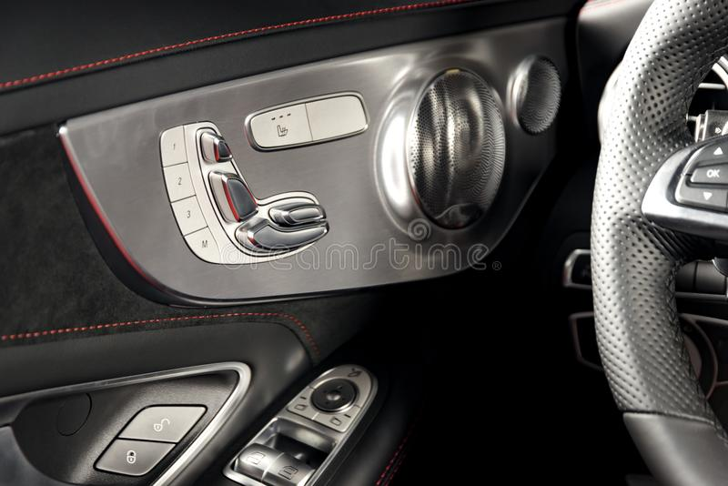 Door handle with Power seat control buttons of a luxury passenger car royalty free stock images