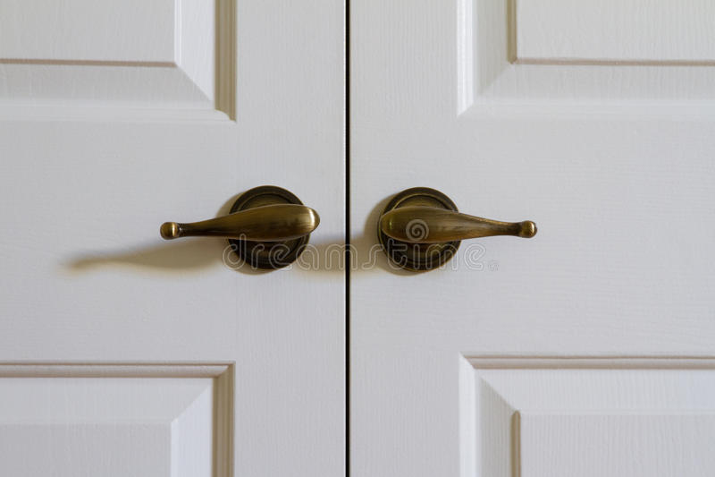 Door handles of closed double doors royalty free stock image
