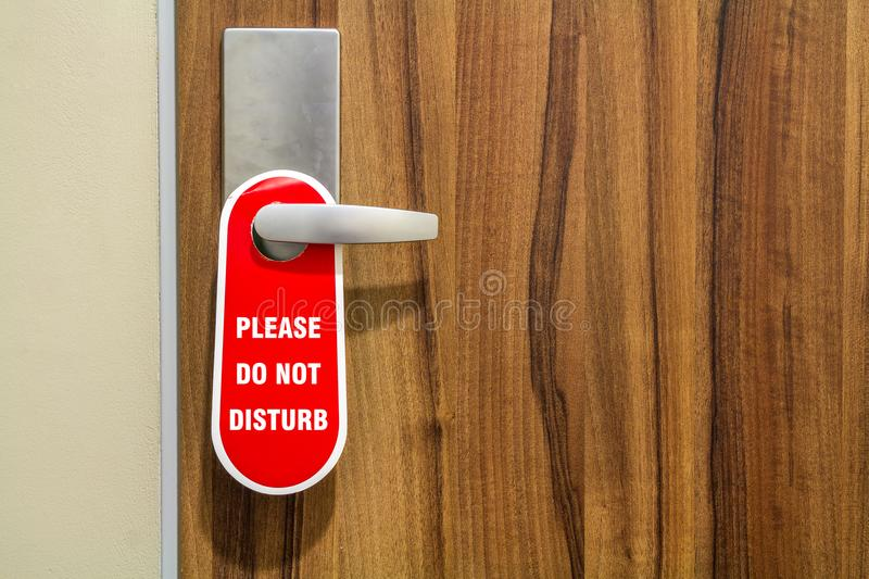 Door of hotel room with sign please do not disturb. stock images