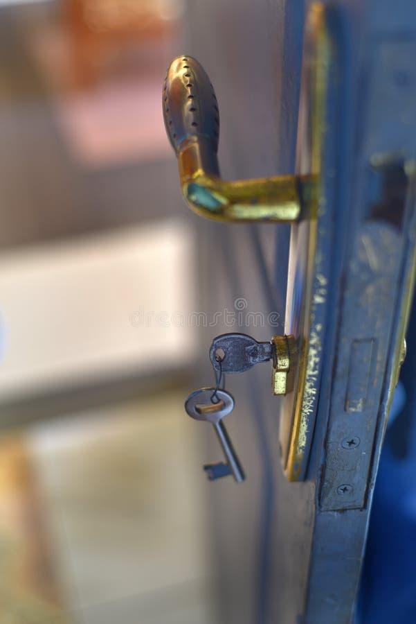 Door key hanging on the key hole stock photos