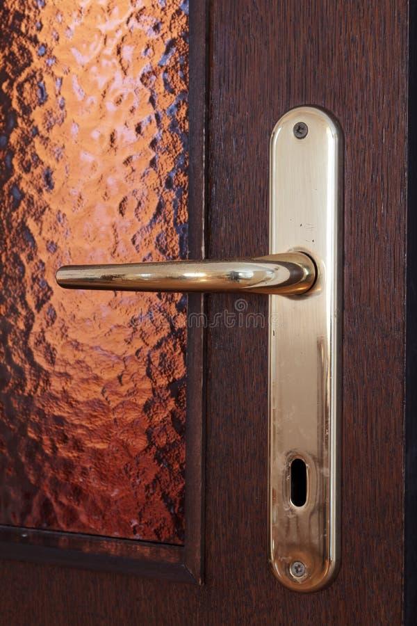 Door knob. Shot of wooden doors and door knob royalty free stock photo