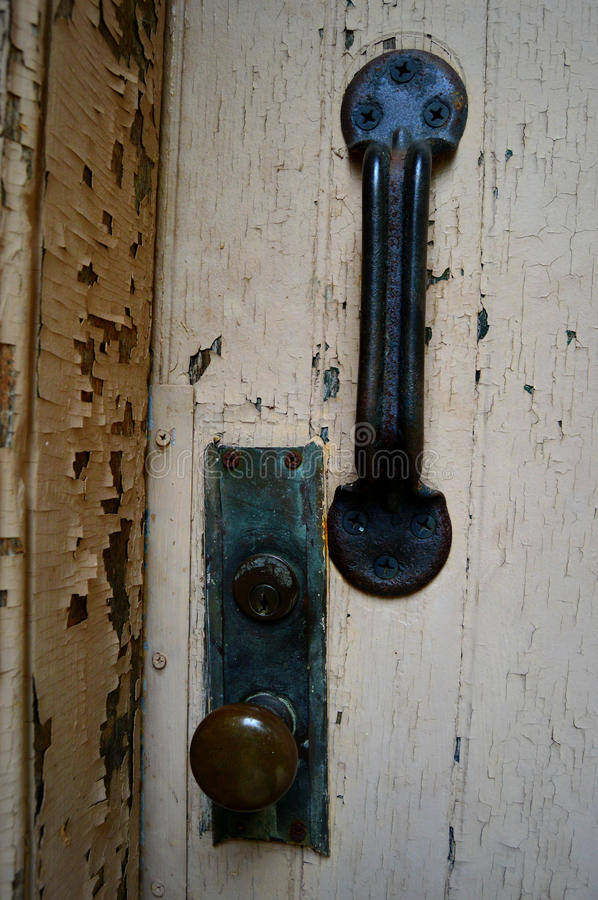 Door Handle. This is a door knob, lock and handle from an old door with peeling paint. This was taken at the Yerkes Observatory in Williams Bay, WI stock photos