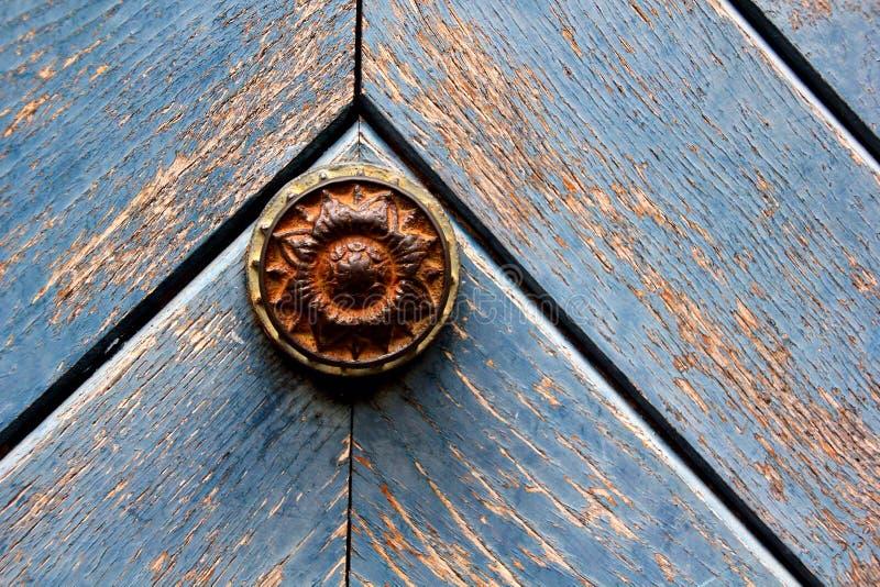 Door Knob. Rustic door knob on a weathered door stock images