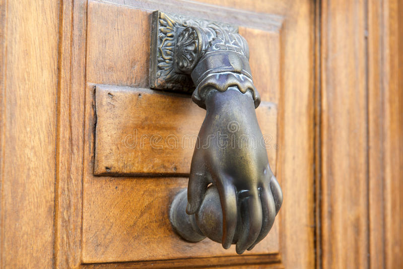 Door knocker. Detail of door knocker on a building exterior royalty free stock photography