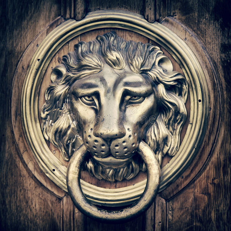 Door knocker, handle - lion head. Vintage stylized. royalty free stock image