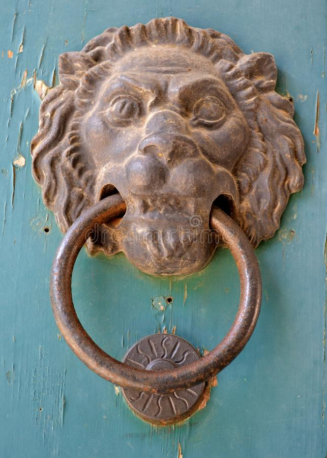 Door knocker with a lion royalty free stock image