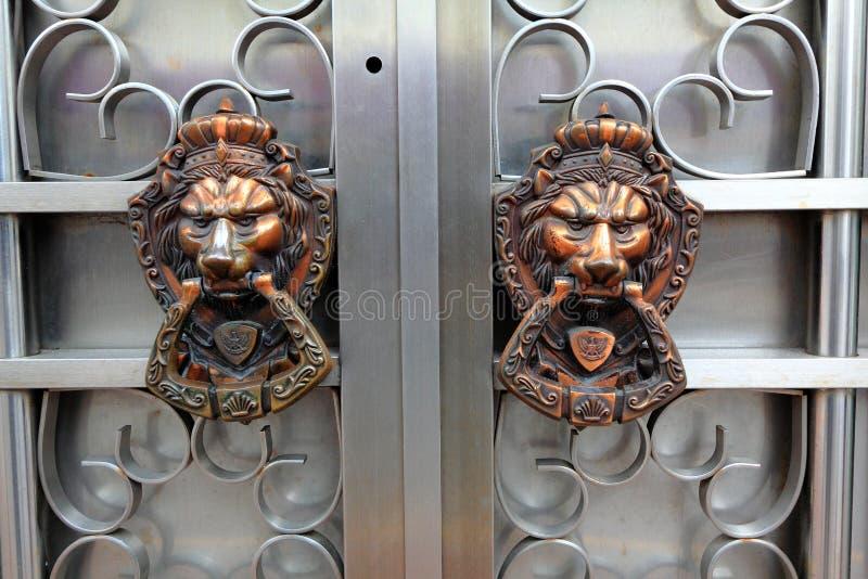Door knocker in Macau. A pair of door knocker of a house hold in Macua stock images
