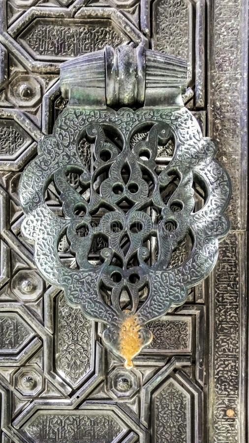 Door knocker in a Mozarab style stock photo