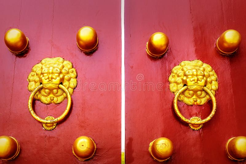 Door knockers in the temple of heaven in beijing royalty free stock photo